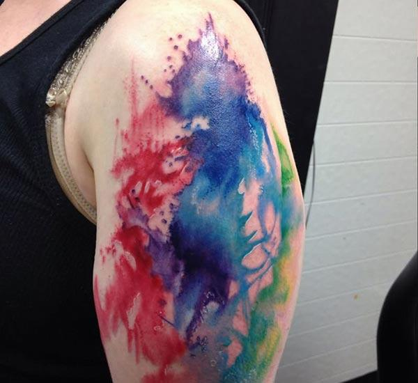 Vibrant and funky ink splash water color shoulder tattoo ideas for guys