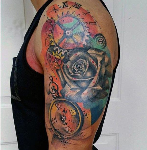 Cool and stunning combination of compass, rose and time machine water color shoulder tattoo ideas for Men