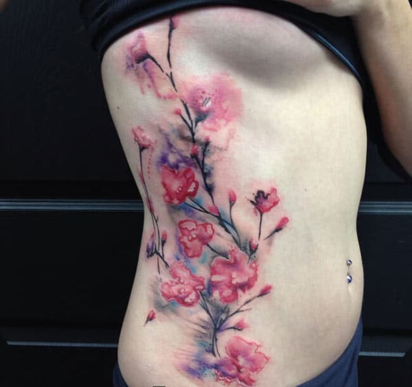 Awesome cherry blossom branch watercolor side tattoo ideas for Ladies