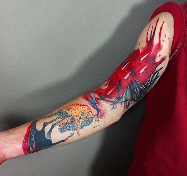 Bright-colored watercolor tattoo on sleeve ideas for men