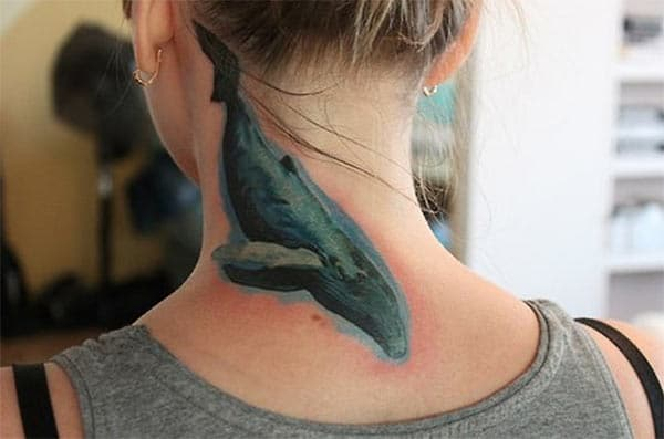 Splendid blue whale watercolor tattoo design on back neck for Girls