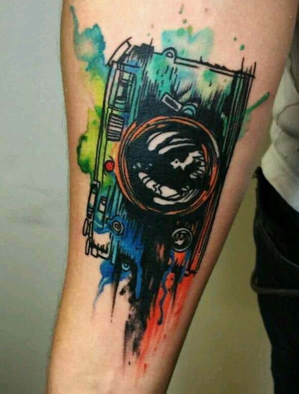 Elegant and embellished forearm water color ink tattoo ideas for Boys to showcase love for Photography