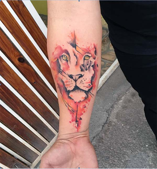 Eye-catchy and glaring lion Water color ink forearm tattoo ideas for men