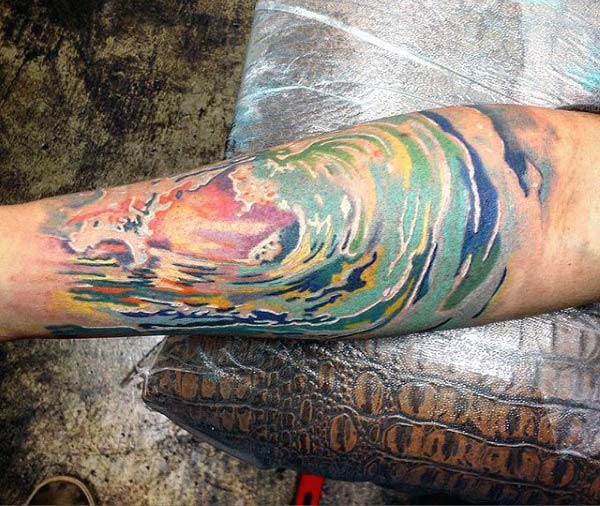 Dynamic wave Water color ink Forearm tattoo ideas for adventurous men