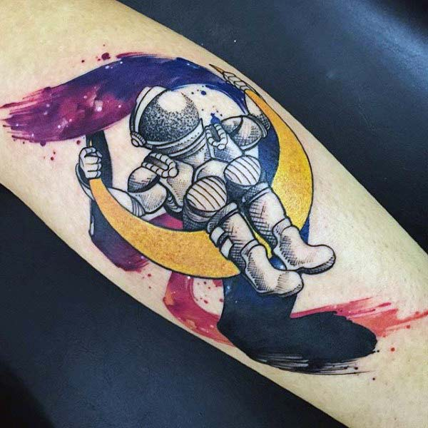 Take love for space to next level with cool geared Astronaut on moon water color Forearm tattoo ideas for boys
