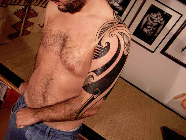 Stylish half sleeve tribal tattoo design for Guys