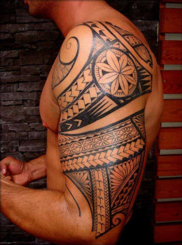 Amazing decorative Maori tribal tattoo designs on arm for guys