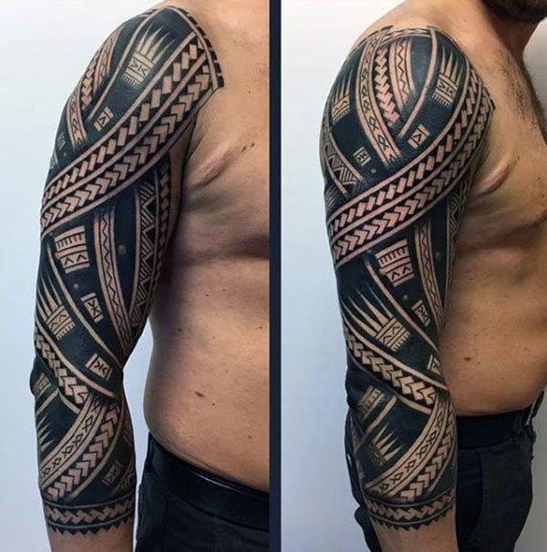 Striking bold black line tribal tattoo ideas for Boys on Arm