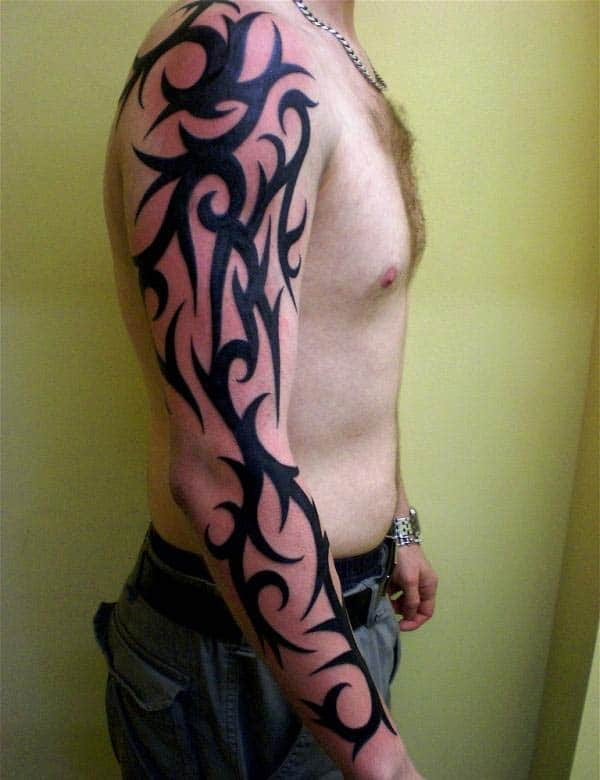 Ornamental tribal tattoo designs on arm for boys