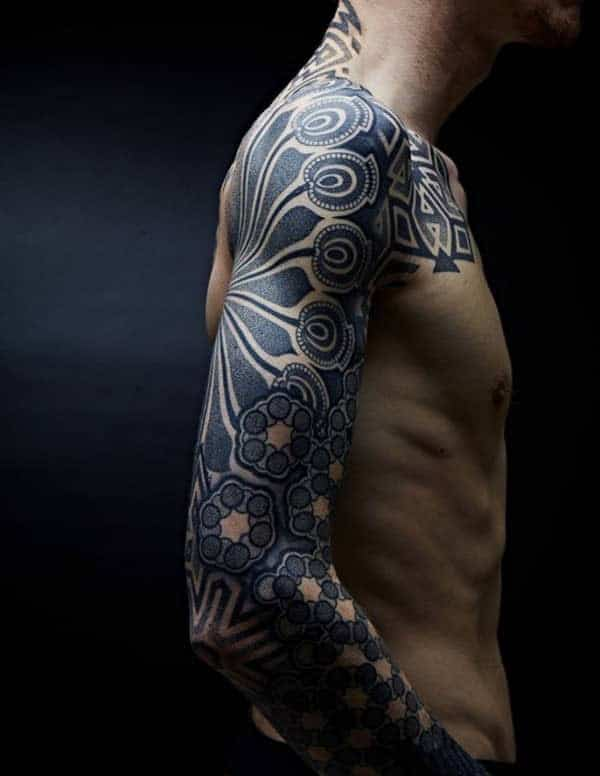 Captivating bold tribal tattoo ideas on arm for Men