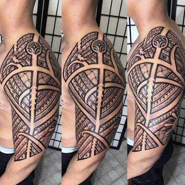 Imposing Filipino Tribal Tattoo ideas on Arm for Guys