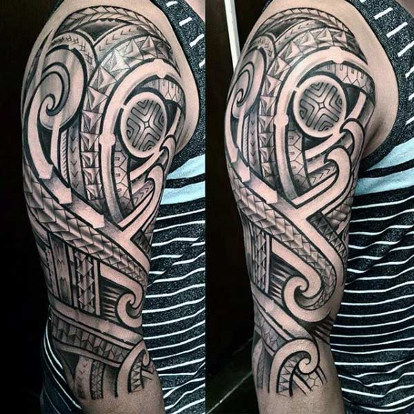 Striking bold geometric Filipino tribal tattoo ideas on sleeve for Men