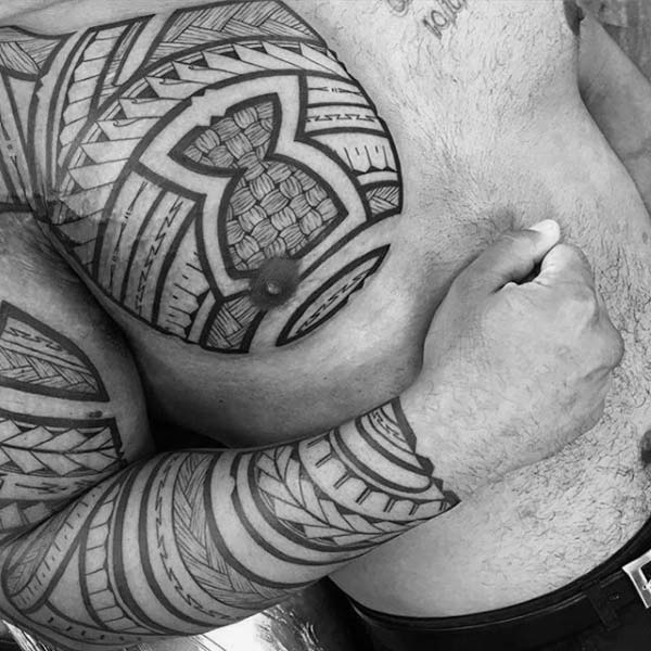 Smashing geometric lines Filipino tribal tattoo ideas on front shoulder and arm for Boys and Men