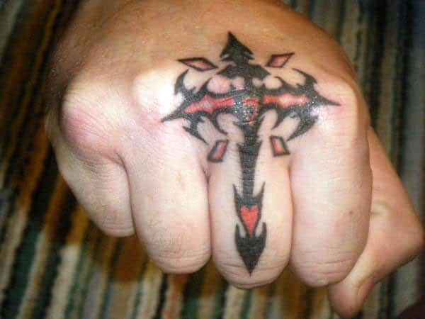 Tiny black red tribal cross tattoo designs on fingers for Guys