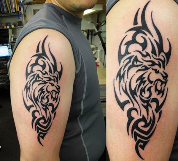 Fascinating complex tribal lion head tattoo ideas on arm for boys and men