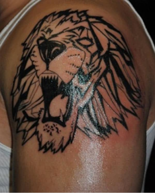 Roaring lion face Geometric lined tattoo designs on shoulder for Boys