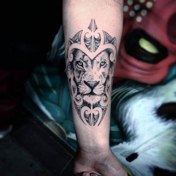 Charming glaring lion face tribal tattoo ideas on arm for boys and men