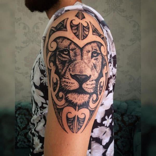 Magnificent dotted lion face tribal tattoo designs on shoulder for Guys