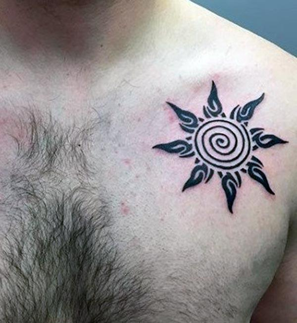 Simple yet catchy tribal sun tattoo on front shoulder for Guys