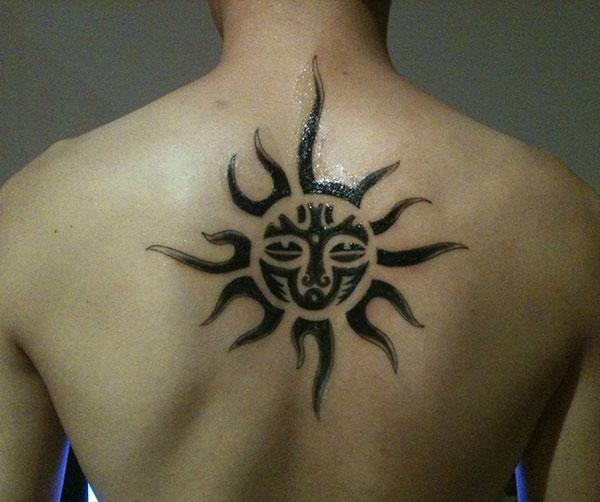 Enchanting sun god tribal back tattoo designs for Guys
