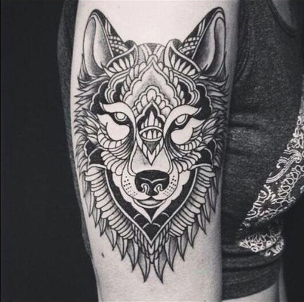 Artistic and glaring wolf face tribal tattoo ideas for Girls and women on arm