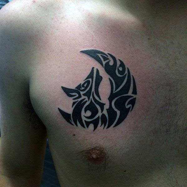 Delightful Celtic tribal howling wolf under moon tattoo ideas on chest for boys and men