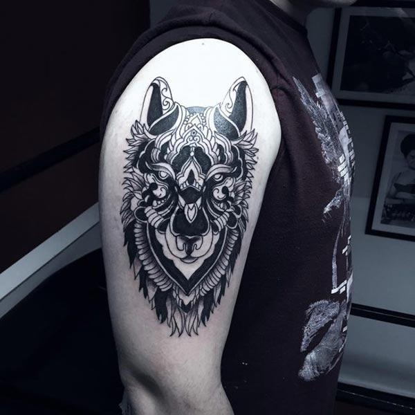 Hypnotizing artistic wolf head tribal tattoo ideas on arm for Men