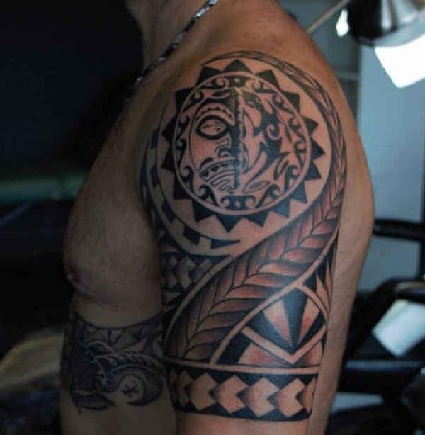 Brilliant red black Aztec tribal shoulder tattoo design on Guys
