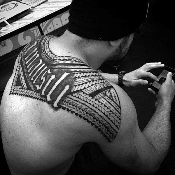 Breathtakingly intricate Hawaiian tribal tattoo ideas for Guys on upper back