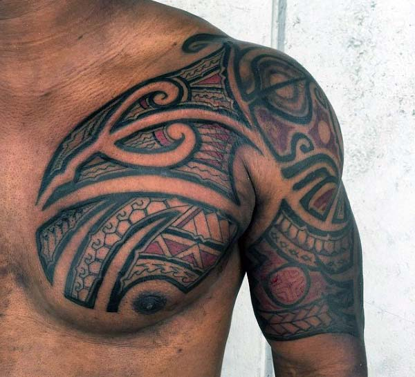 Brilliantly artistic red black Hawaiian tribal chest and arm tattoo ideas for Men