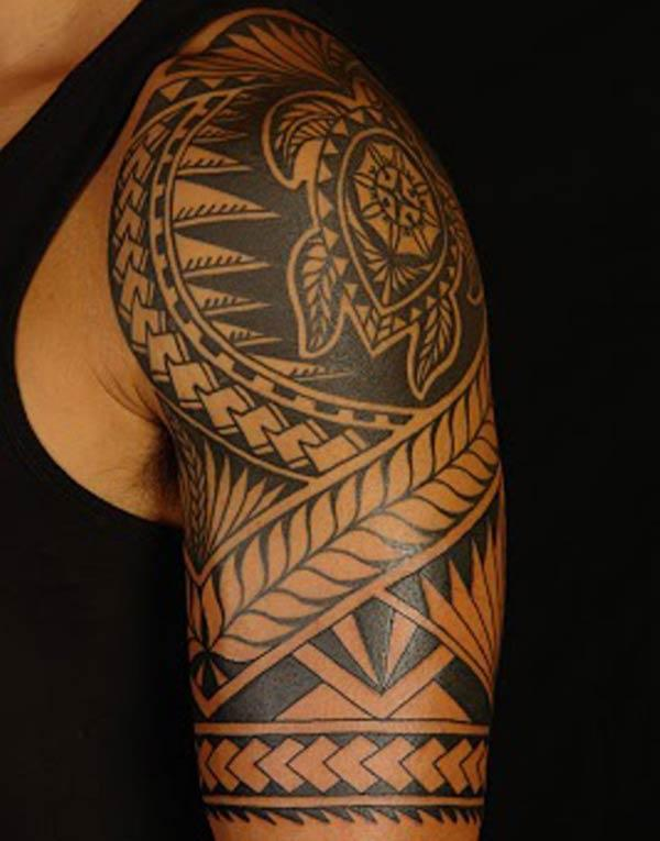 Beautiful aesthetic looking Turtle centered Hawaiian Tribal Tattoo on shoulder for Guys