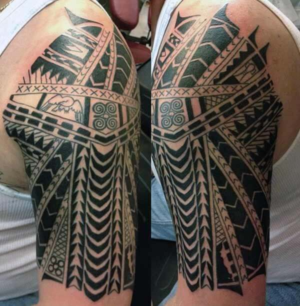 Captivating intense black Samoan tribal shoulder tattoo for boys