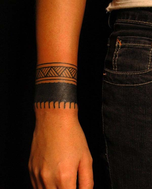 Attractive broad and intense black tribal armband tattoo ideas for ladies