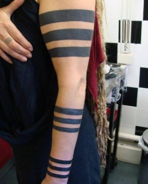 Captivating intense black tribal armband tattoo ideas for girls and women
