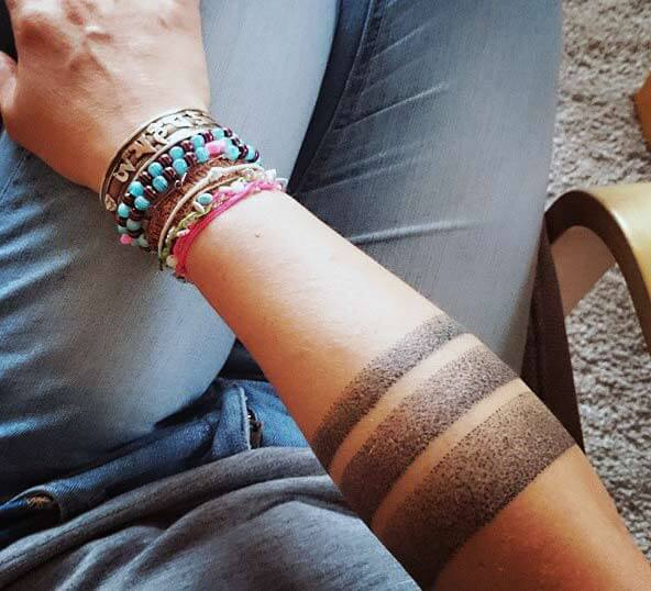 Enchanting dotted armband tribal tattoo designs for Ladies