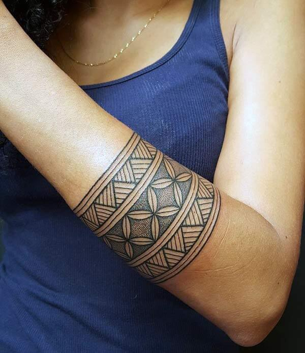 71042b0f89f05 Incredible broad tribal armband tattoo ideas for ladies