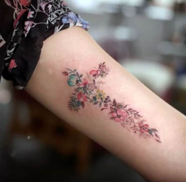Beautiful astounding floral cross ideas tattoo in arm for girls