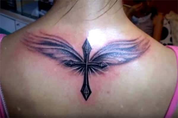 Awe-inspiring cross with wings tattoo ideas on back for ladies and girls