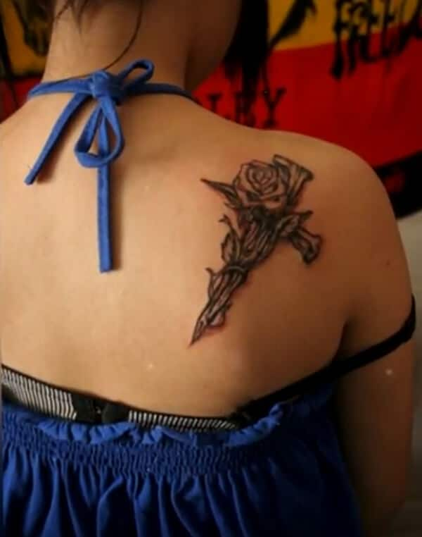 Arresting thorn shaped cross with rose tattoo ideas in back for ladies