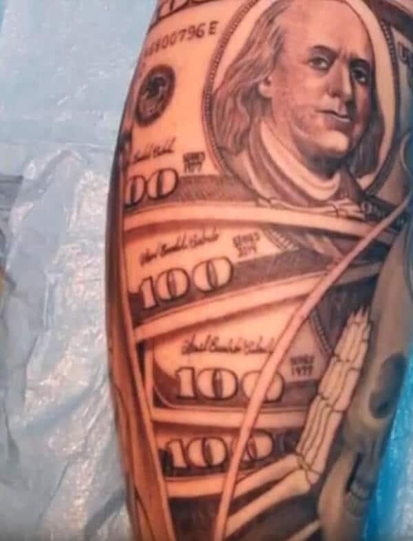 Brilliant money along with skull tattoo designs on arm for Guys