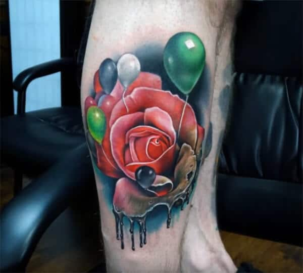 A mesmerizing 3D red rose with balloons tattoo ideas on leg for men