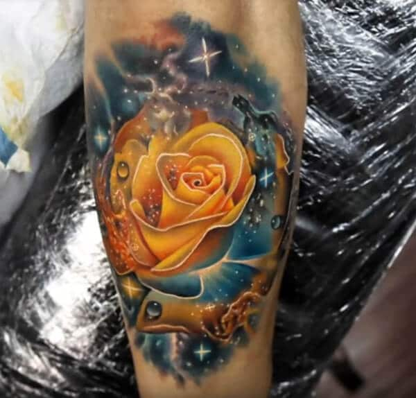 Splendid piece of art of rose in universe tattoo ideas on arm for Boys