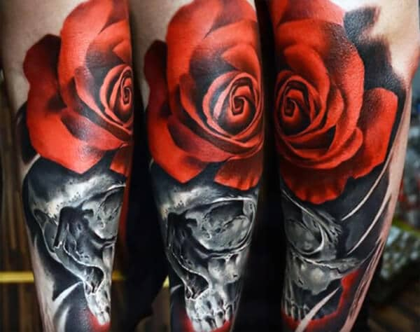 Awesome 3D red rose on skull tattoo ideas on arm for Men