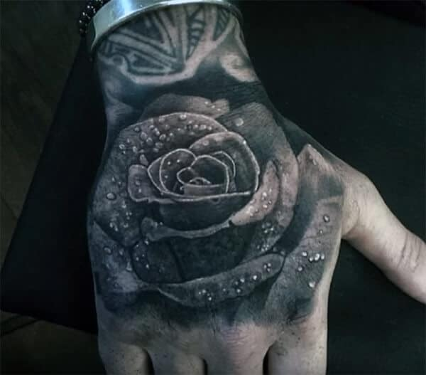 Mind blowing 3D rose with droplets tattoo designs on hand for Guys