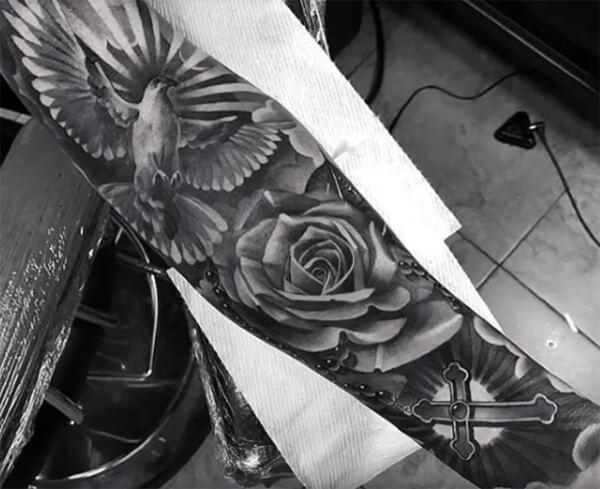 Stunning 3D bird, cross and rose tattoo designs on full sleeve for Guys