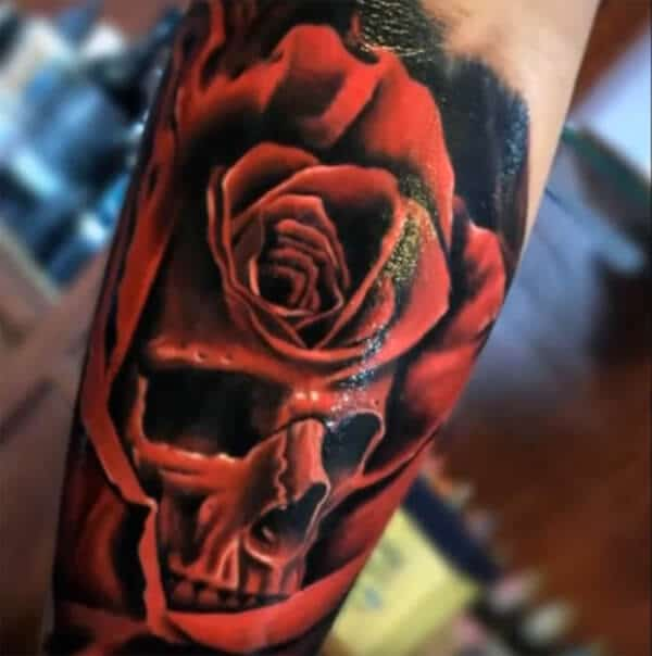 Breathtaking red rose on skull tattoo ideas for Men on arm
