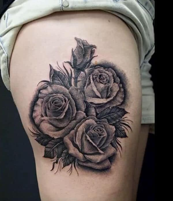 Arresting roses tattoo ideas on thigh for Ladies