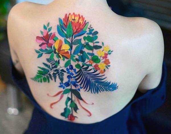 vibrant floral back tattoo design ideas for girls and women