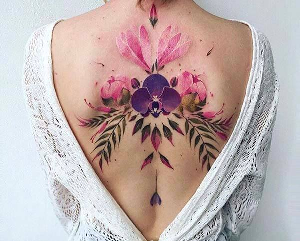 vividly colourful back tattoo design for girls and ladies