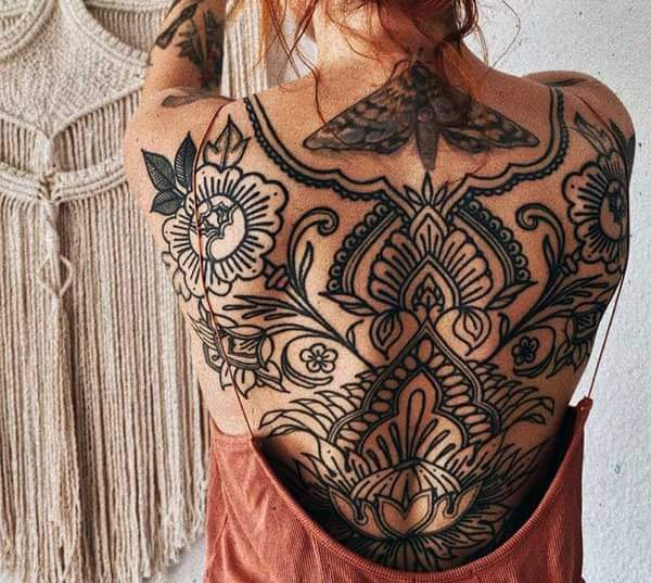 prepossessing back tattoo of intricate designs for girls